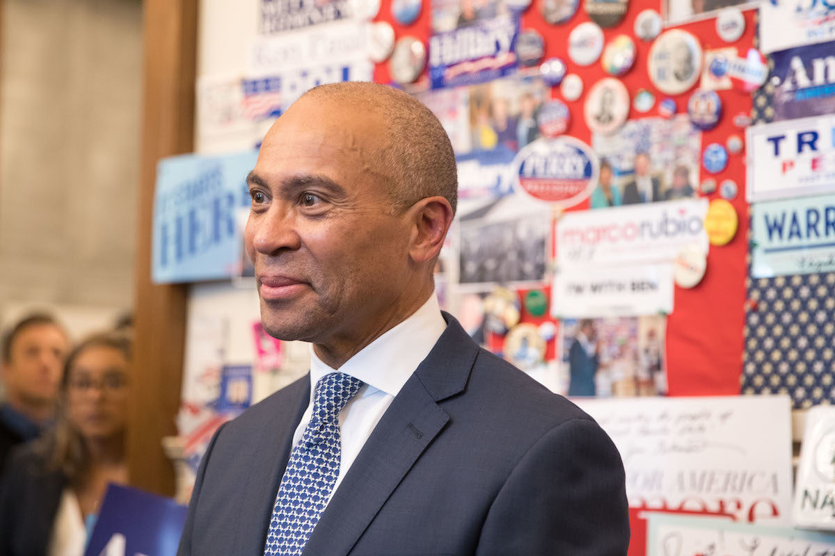 Former Massachusetts Governor Deval Patrick stands in the visitor center of the New Hampshire State House after he filed his paperwork to run for president in 2020