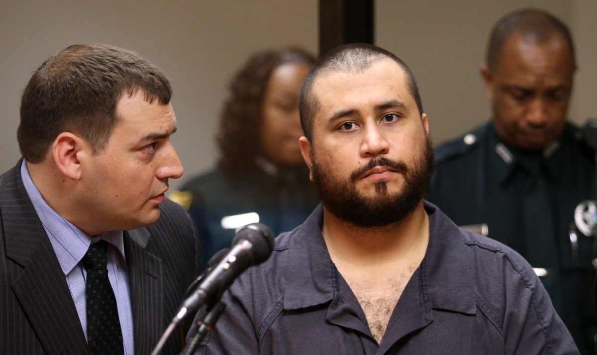 SANFORD, FL - NOVEMBER 19: George Zimmerman, the acquitted shooter in the death of Trayvon Martin, listens to defense counsel Daniel Megaro (L) during a first-appearance hearing on charges including aggravated assault stemming from a fight with his girlfriend November 19, 2013 in Sanford, Florida. Zimmerman, 30, was arrested after police responded to a domestic disturbance call at a house. He was acquitted in July of all charges in the shooting death of unarmed, black teenager, Trayvon Martin. (Photo by Joe Burbank-Pool/Getty Images)