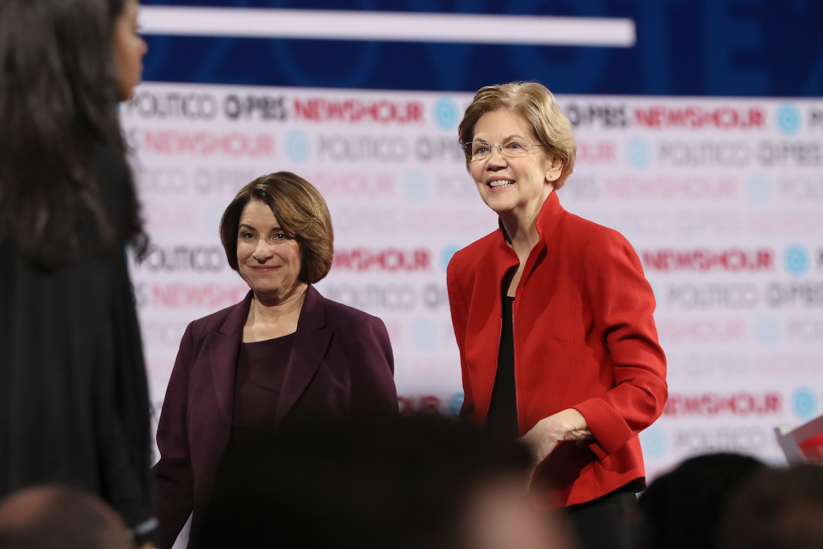 Democratic presidential candidate Sen. Elizabeth Warren (D-MA) (R) and Sen. Amy Klobuchar (D-MN)) walk on the stage after the Democratic presidential primary debate