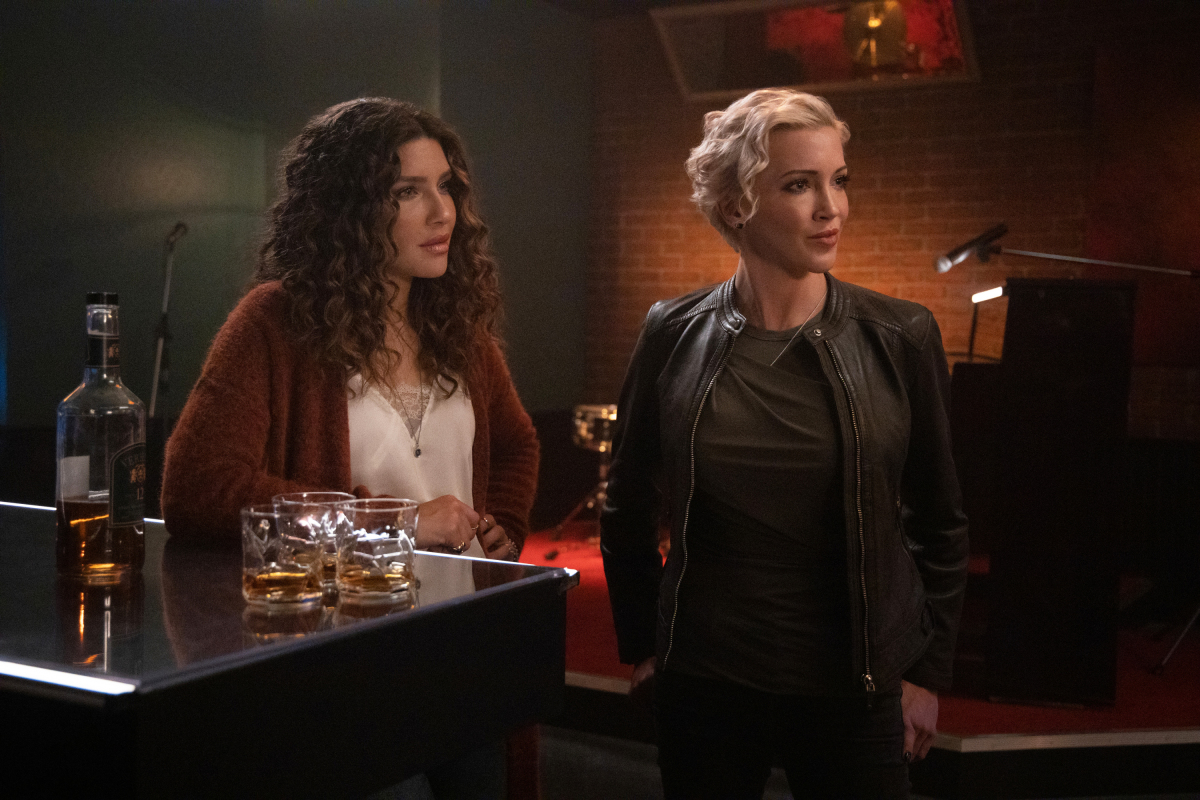"""Arrow -- """"Green Arrow & The Canaries"""" -- Image Number: AR809e_0683r.jpg -- Pictured (L-R): Juliana Harkavy as Dinah Drake/Black Canary and Katie Cassidy as Laurel Lance/Black Siren -- Photo: Jack Rowand/The CW -- © 2020 The CW Network, LLC. All Rights Reserved."""