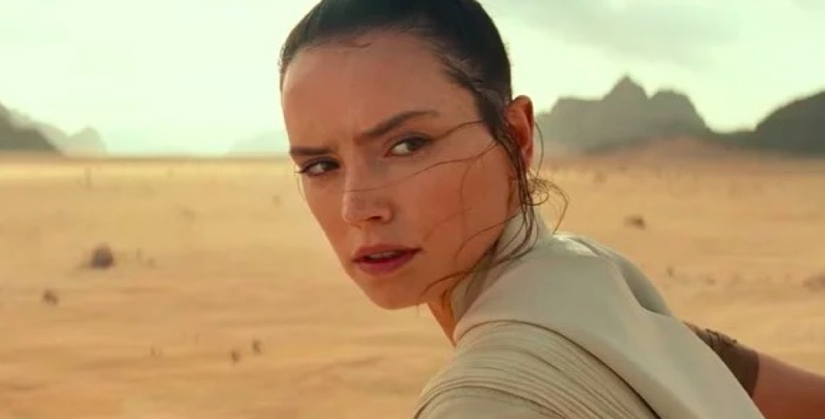 Rey looks over her shoulder in Star Wars: The Rise of Skywalker.