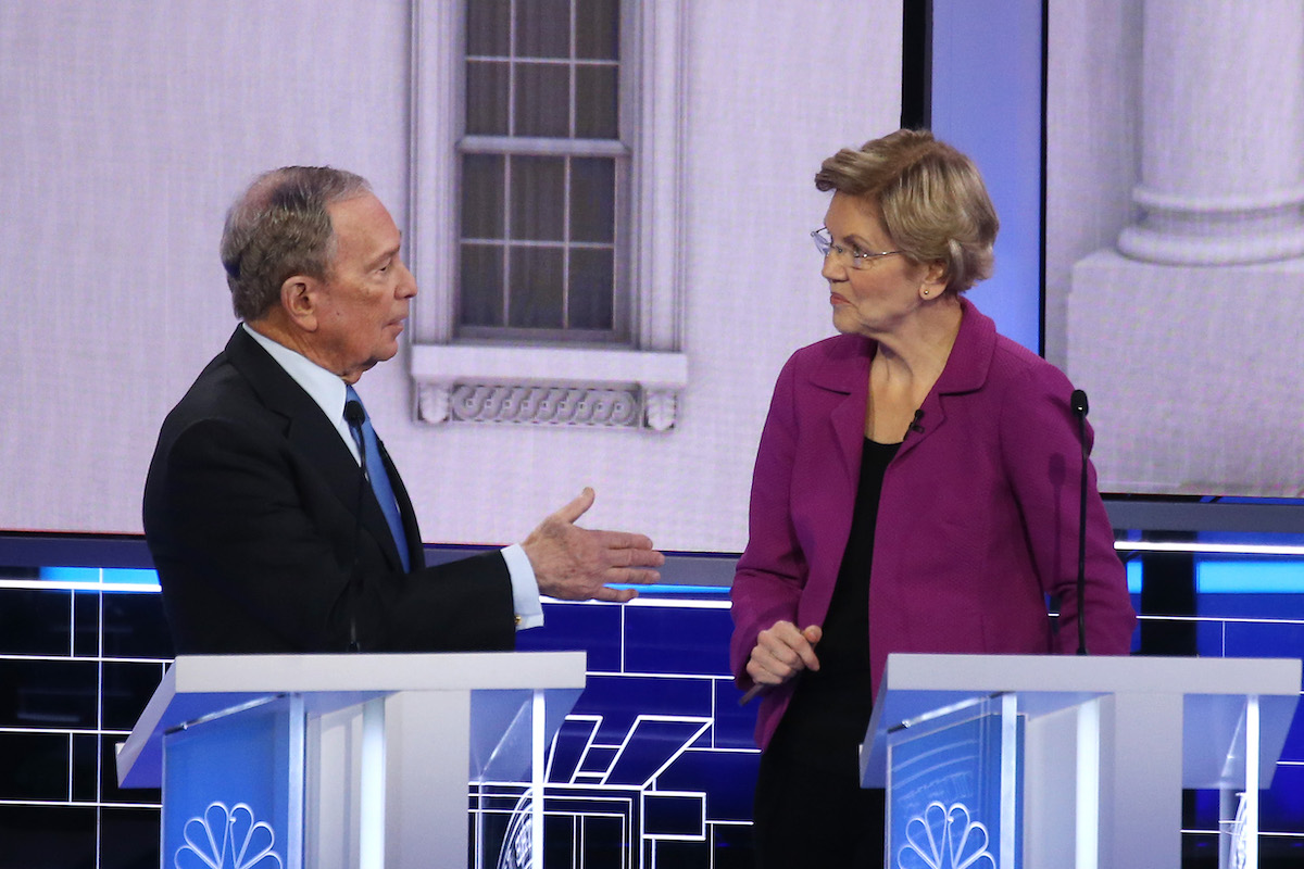 Democratic presidential candidates (L-R) former New York City Mayor Mike Bloomberg and Sen. Elizabeth Warren (D-MA) speak during the Democratic presidential primary debate