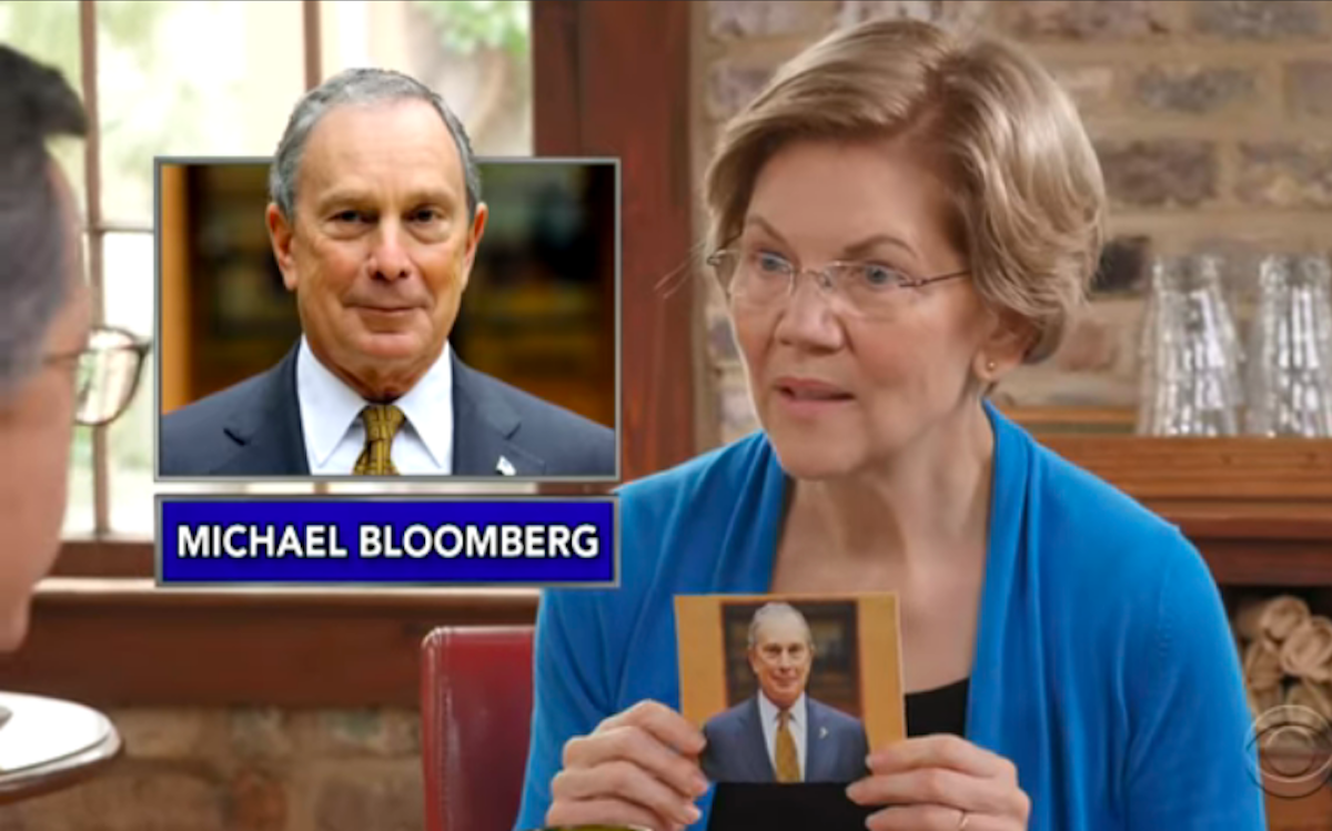 """Elizabeth Warren holds up a picture of Mike Bloomberg during """"Name That Billionaire"""" with Stephen Colbert"""