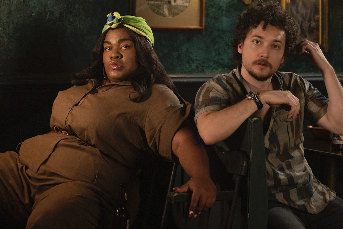 High Fidelity's Cherise (Da'Vine Joy Randolph) and Simon (David H. Holmes) sit side by side, looking at the camera.
