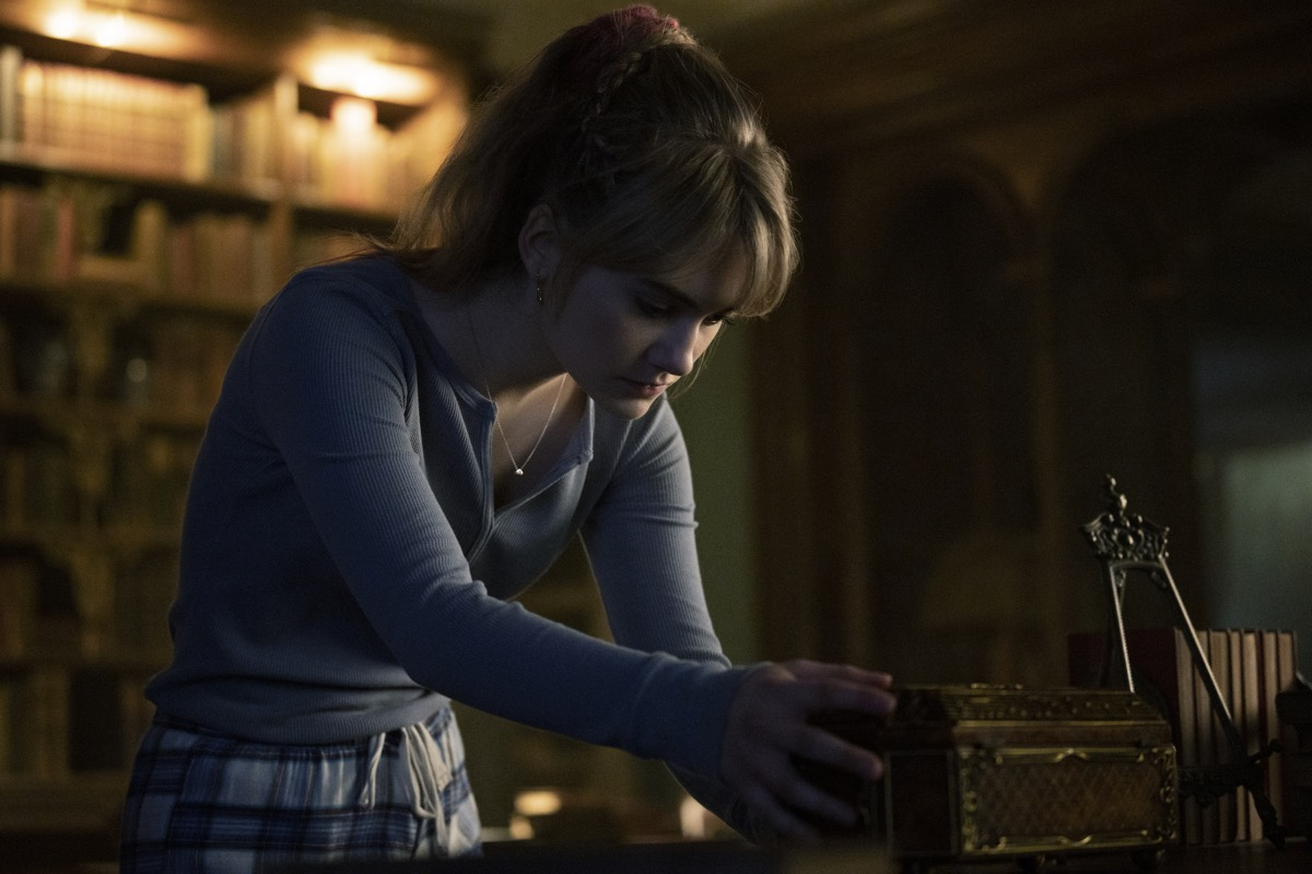 Kinsey peers into a box in Netflix's Locke and Key.