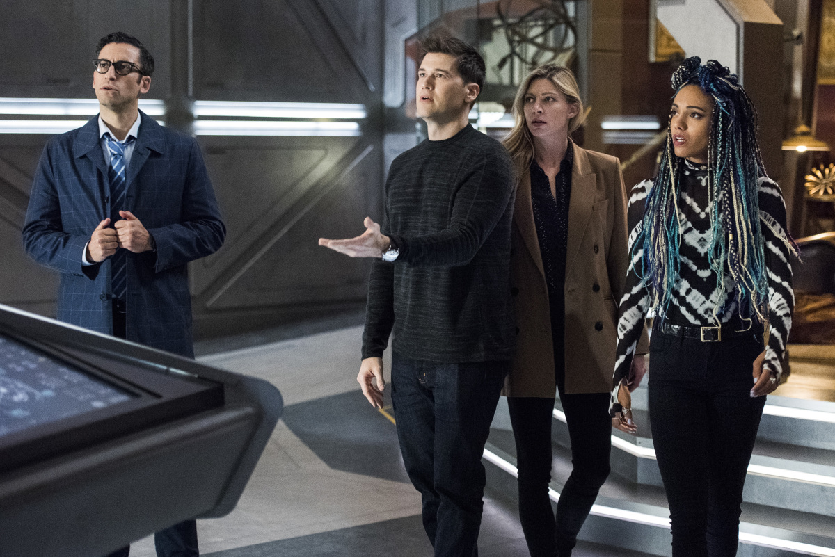 "Legends of Tomorrow -- ""The Great British Fake Off"" -- Image Number: LGN510b_0164b.jpg -- Pictured (L-R): Adam Tsekhman as Agent Gary Green, Nick Zano as Nate Heywood/Steel, Jes Macallan as Ava Sharpe and Maisie Richardson-Sellers as Charlie -- Photo: Dean Buscher/The CW -- © 2020 The CW Network, LLC. All Rights Reserved."