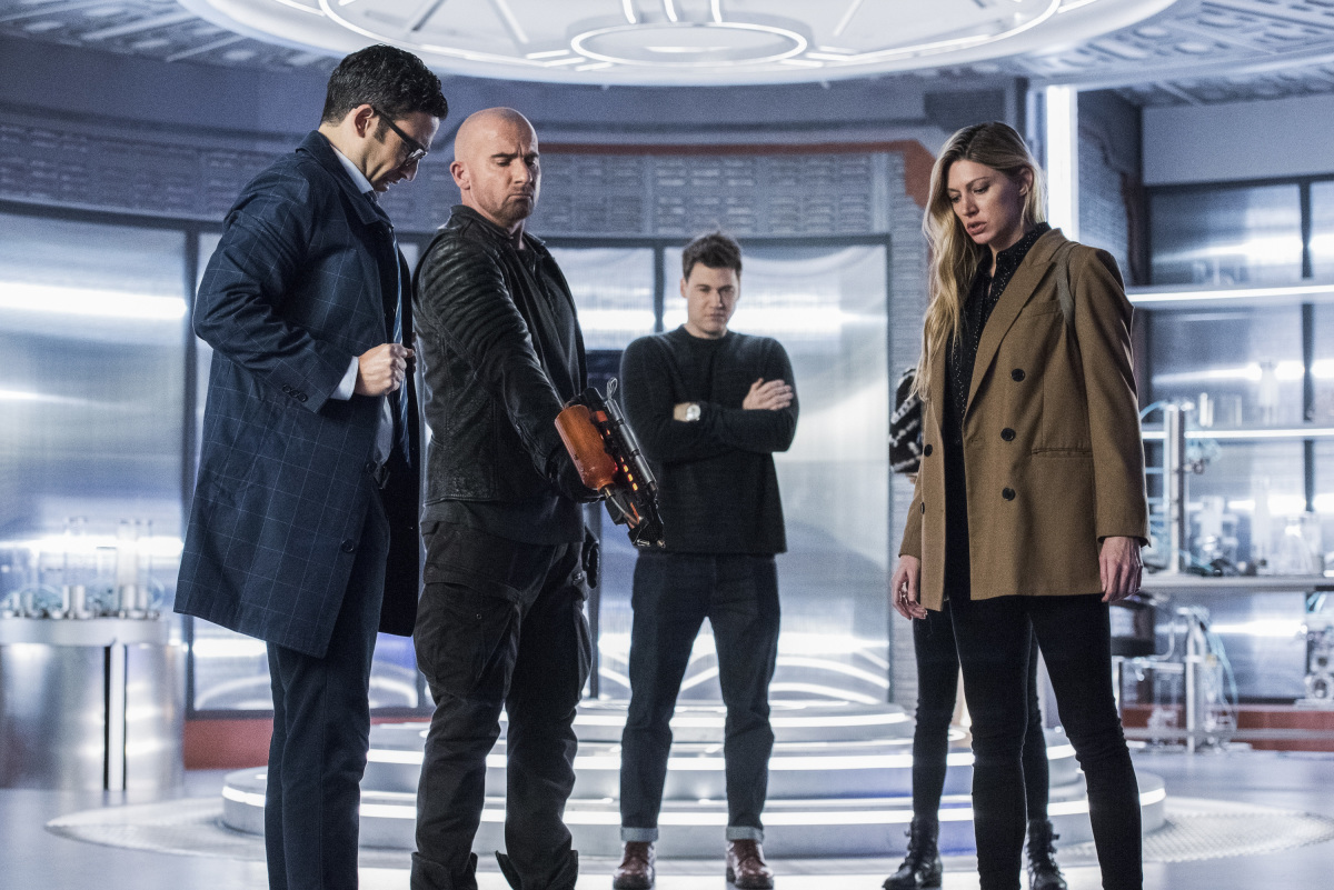 "Legends of Tomorrow -- ""The Great British Fake Off"" -- Image Number: LGN510b_0421b.jpg -- Pictured (L-R): Adam Tsekhman as Agent Gary Green,  Dominic Purcell as Mick Rory/Heatwave, Nick Zano as Nate Heywood/Steel and Jes Macallan as Ava Sharpe -- Photo: Dean Buscher/The CW -- © 2020 The CW Network, LLC. All Rights Reserved."