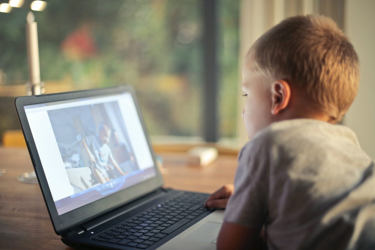 child watching video on computer