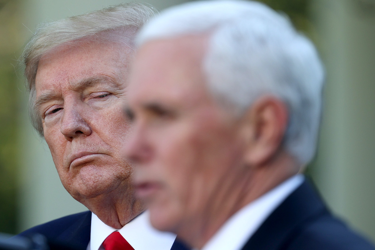Trump appears to glare at Mike Pence during a White House press briefing.
