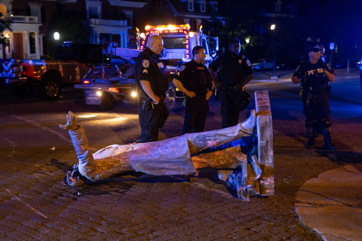 A statue of Confederate States President Jefferson Davis lies on the street after protesters pulled it down in Richmond, Virginia, on June 10, 2020. - The symbols of the Confederate States and its support for slavery are being targeted for removal following the May 25, 2020, death of George Floyd while in police custody. (Photo by Parker Michels-Boyce / AFP) (Photo by PARKER MICHELS-BOYCE/AFP via Getty Images)