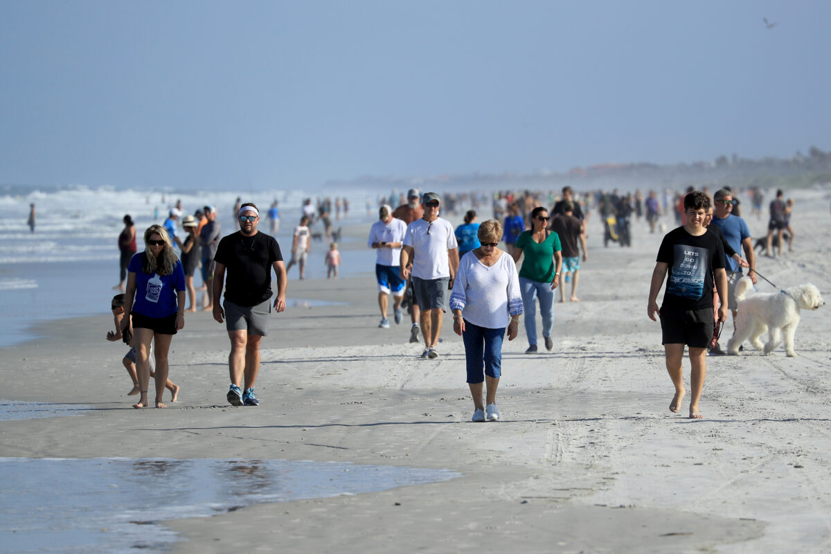 JACKSONVILLE BEACH, FLORIDA - APRIL 17: People are seen at the beach on April 17, 2020 in Jacksonville Beach, Florida. Jacksonville Mayor Lenny Curry announced Thursday that Duval County's beaches would open at 5 p.m. but only for restricted hours and can only be used for swimming, running, surfing, walking, biking, fishing, and taking care of pets. (Photo by Sam Greenwood/Getty Images)