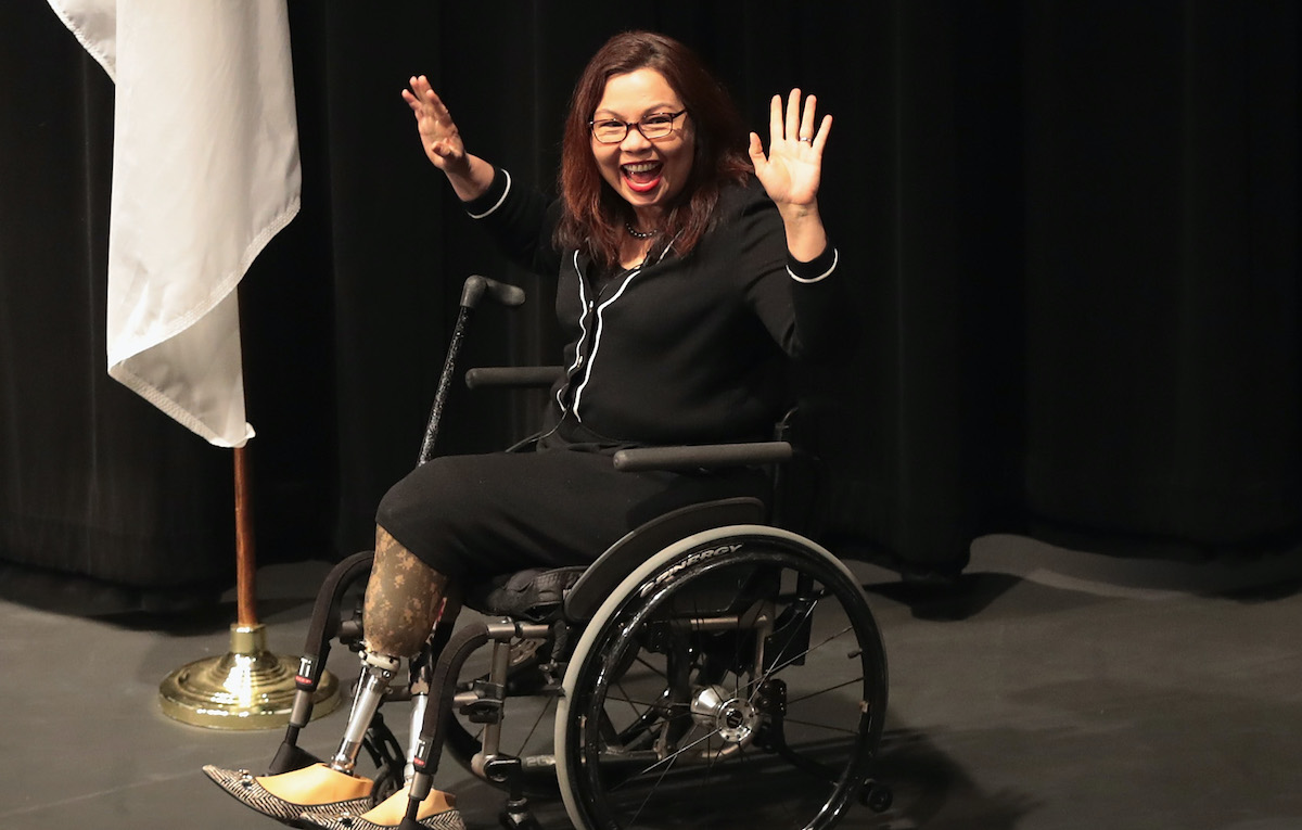 Tammy Duckworth laughing.