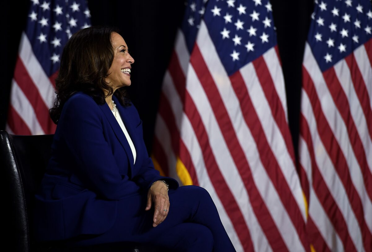 Democratic vice presidential running mate, US Senator Kamala Harris, smiles as she listens to presidential nominee and former US Vice President Joe Biden speak during their first press conference together in Wilmington, Delaware, on August 12, 2020. (Photo by Olivier DOULIERY / AFP) (Photo by OLIVIER DOULIERY/AFP via Getty Images)
