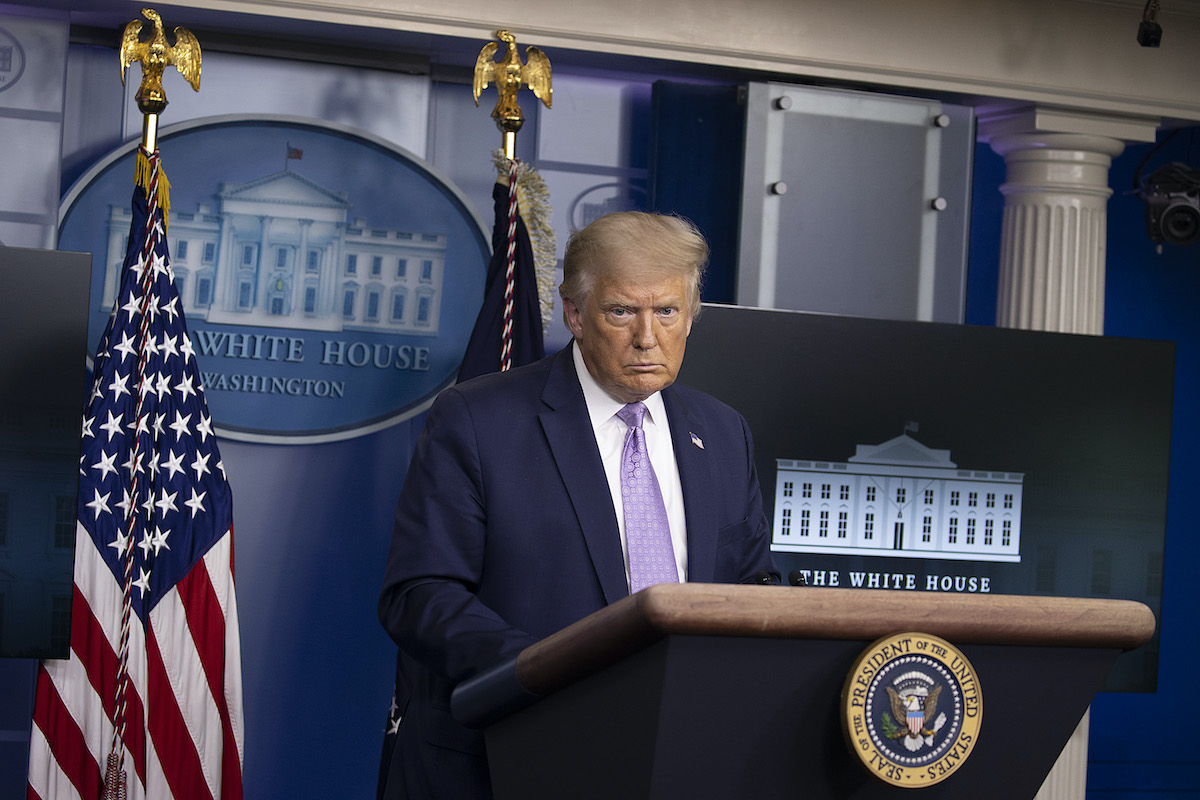 Donald Trump pouts during a press briefing.
