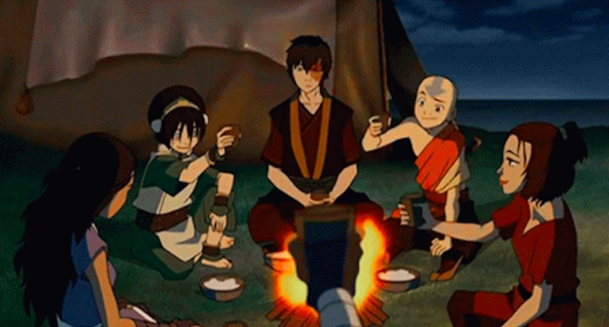 Avatar: The Last Airbender gaang sitting around a fire.
