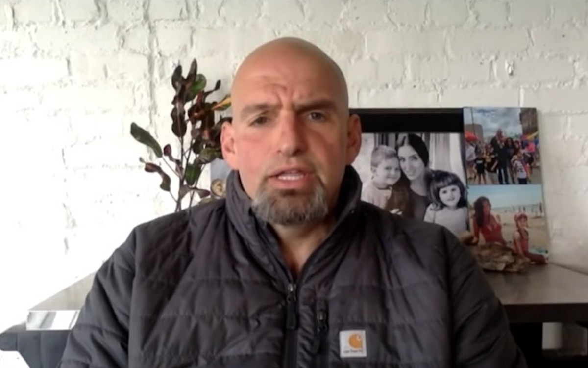John Fetterman appears on MSNBC in front of pictures of his family.