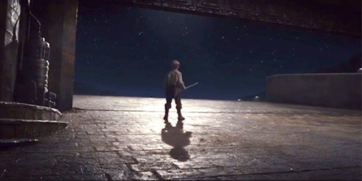 """Broom kid"" looking out into space at the end of Star Wars: The Last Jedi."