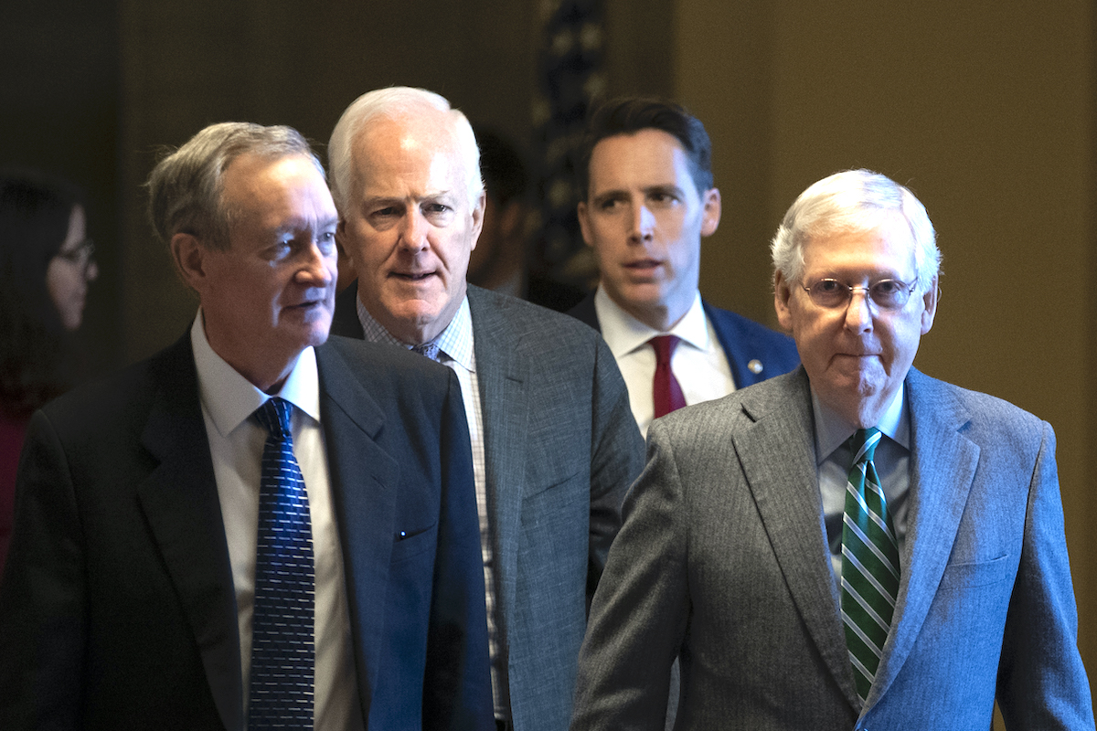 (L-R) Sen. Mike Crapo (R-ID), Sen. John Cornyn (R-TX), Sen. Josh Hawley (R-MO) and Senate Majority Leader Mitch McConnell (R-KY) leave McConnell's office and walk to the Senate chamber