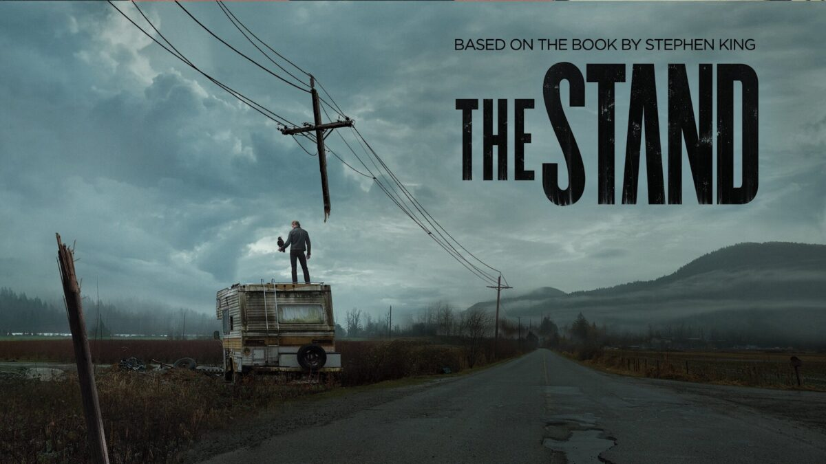 CBS The Stand adaptation image of a road and an RV with a man standing on it.