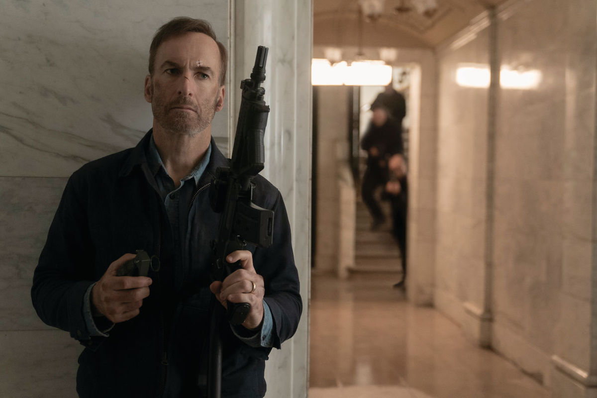 Bob Odenkirk holds an assault rifle in Nobody
