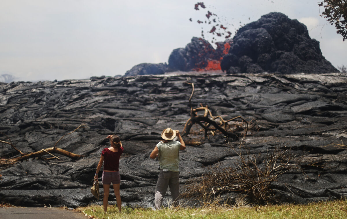 Pahoa, Hawaii-May 24: Kate Lily (L) and Will Diwan watched when lava erupted from the Kilauea volcano rift at Lailani Estate in Hawaii