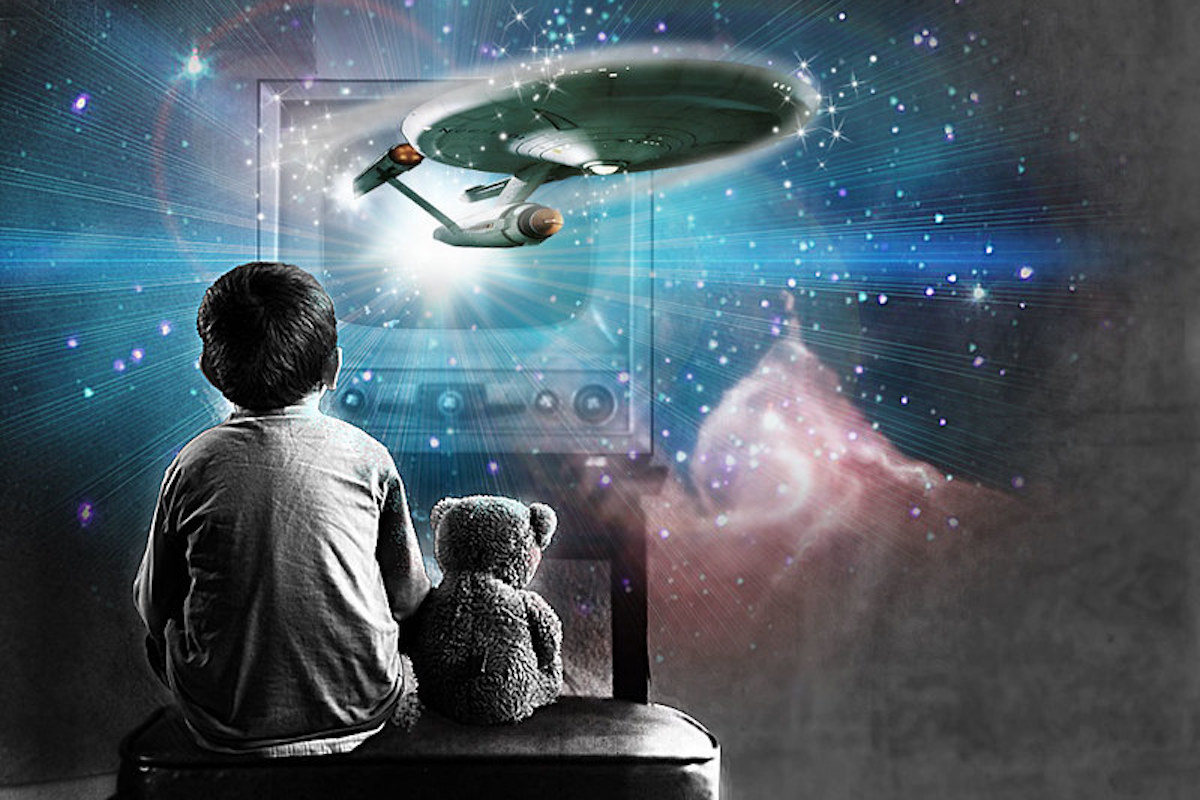 A child sits with a teddy bear watching television as the starship enterprise and celestial images hover around them