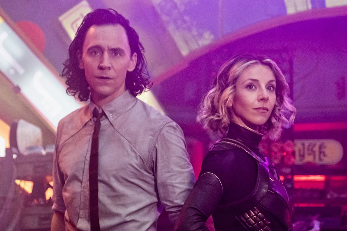 Loki and Sylvie stand next to each other, looking out in a promo image for Loki