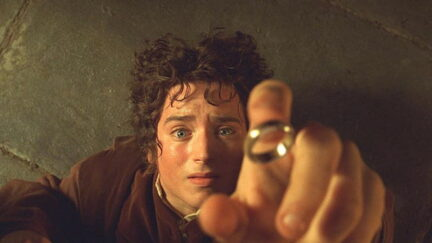 Elijah Wood as Frodo Baggins reaches for the One Ring in Lord of the Rings: The Fellowship of the Rings