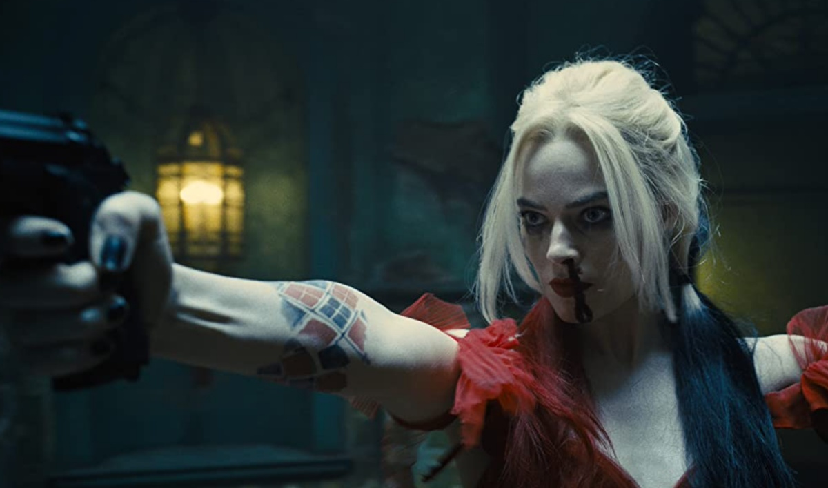 Margot Robbie in The Suicide Squad (2021) as Harley Quinn with a gun and serving looks