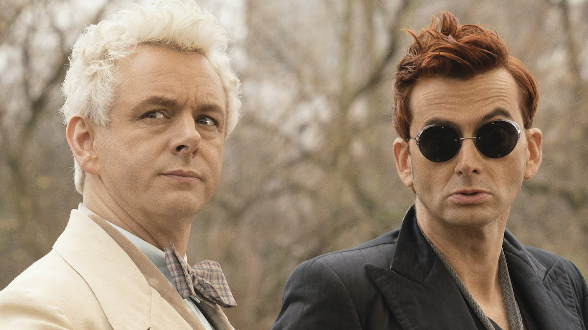 Michael Sheen as the angel Aziraphale sits next to David Tennant in sunglasses as the demon Crowley in 'Good Omens'