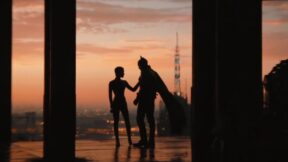 Batman and Catwoman posing in the sun in the new trailer for The Batman